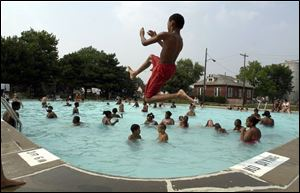 Residents pack the pool at  Jamie Farr Park in North Toledo. It is one of the city pools that opened recently; two others have been closed.