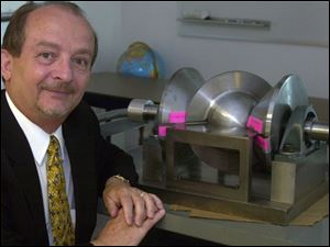 Ron McMaster, with the lightweight spherical engine that has a round 'wobble plate.'