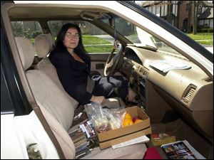 Diane Monaco has lots of supplies for her 140-mile round-trip commute to and from Manchester College in Indiana.