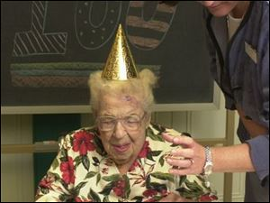 Margaret O'Hearn turned 100 years old on July 3. Julie Dangelo gives her a little help with her cake.