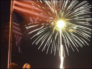 Fireworks light up the night sky over the Maumee River in Toledo in this time-exposure photograph taken from the Martin Luther King, Jr., Bridge. The Promenade Park display was one of about 25 in northwest Ohio and southeast Michigan.