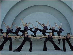Members of the Cassandra Ballet of Toledo practice in the Toledo Zoo Amphitheater for Sunday&#