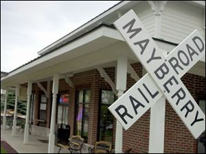 The Mayberry Railroad cross sign marks Mayberry Square, a traditional neighborhood development off of Sylvania-Metamora Road.