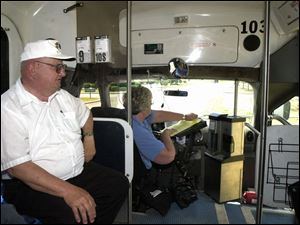 Leo Darmofal makes use of TARTA's Perrysburg Call-A-Ride bus, which is being driven by Betty Armes.