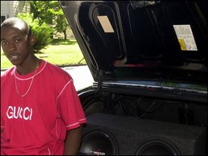 John Walker, 18, of Toledo has two 12-inch subwoofers in the trunk and a 500-watt amplifier but he says he only plays it loud during the daytime because he wants to keep it 'respectable.'