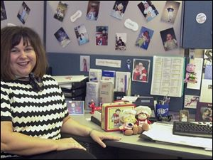 Amy Campbell decorated her office at AAA of Northwest Ohio with photographs of her two children and Campbell Soup memorabilia.