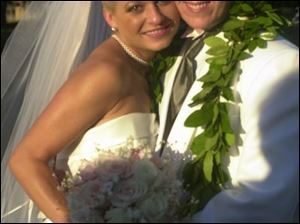 FAMILY EVENT: Nissa Hudak and Ryan Yoder were married at the Yoder home in Whitehouse.