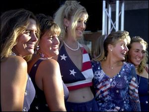The patriotic theme captured the fancy of five women outside the Fox Theatre. Showing heir colors are, from left, Denise Marusak, Missy Misko, Mary Beth Bodrie, Margie Gape, and Michelle Perry-Pandoff, all from Grosse Ile, Mich.