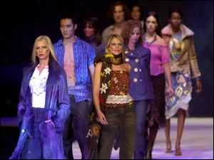 Models on the Fash Bash runway in the Fox Theatre display a variety of attractive and wearable looks.