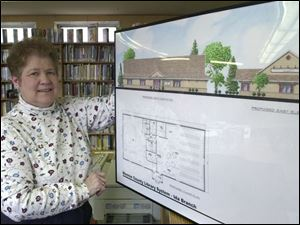 Barb Drodt, Ida librarian, has more than one reason to be happy to get a new library building.