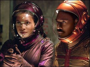 Rosario Dawson and Eddie Murphy play, respectively, a waitress and nightclub owner in The Adventures of Pluto Nash.