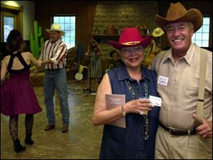 YEE HAW!: Joan and John Coleman suit up in western attire for the Wildwood Metropark barbecue in the pavilion.