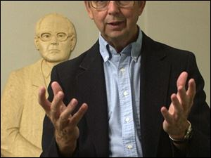 The Rev. Jim Bacik, standing in front of a sculpture of his mentor, Karl Rahner, says the U.S. should seek justice, not war.