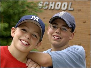 `It can be kind of scary sometimes,' says Mark DeNucci, Jr., right, with his brother, Andy, at Larchmont Elementary. Mark this week began attending DeVeaux Junior High.