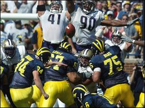 Walk-on placekicker Phillip Brabbs (34) made this winning 44-yard field goal for Michigan, despite missing twice earlier.
