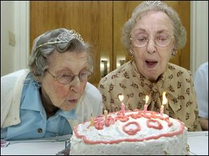 Mary Miller, left, and Florence Marx share a cake to celebrate their 100th birthdays at Browning Masonic Community in Waterville.