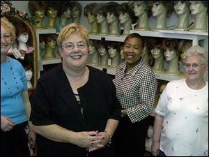 Standing in the wig room at That Special Woman, which caters to cancer patients, are, from left, Carol Burnett, owner Kris Beard, Deborah Roberts, and Nancy Carpenter. All four women discovered lumps through breast self-examinations.