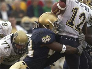 Notre Dame linebacker Justin Tuck hits Pittsburgh quarterback Rod Rutherford, causing a fumble that the Irish recovered during the fourth quarter.