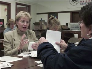 Marcy Kaptur, left, and Sandy Isenberg seal mailers at Lucas County Democratic headquarters in Toledo as fall election campaigns wind down.