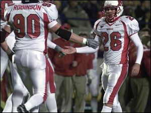 Miami kicker -- and St. John's Jesuit graduate -- Jared Parseghian (26) is congratulated a