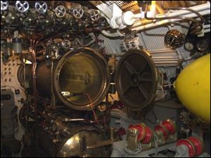 The forward torpedo room of the USS Cod shows how narrow the interior of World War II-era submarines were, measuring in this instance only 16 feet across.