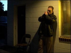 Johnny Reed plays his harmonica before a show at Hines Farm in Swanton.