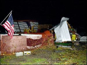 Little remains of a storage building in the village of Jerry City after a suspected tornado swept through the area.