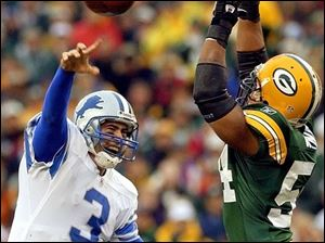 Detroit's Joey Harrington tries to get a pass by the outstretched arms of Green Bay's Nate Wayne.