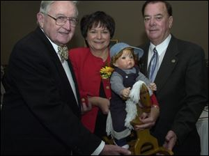 BENEFIT: Walter Grady, from left, Mary Ann Kania, holding a doll she made, and Jack Mixon at a dinner.