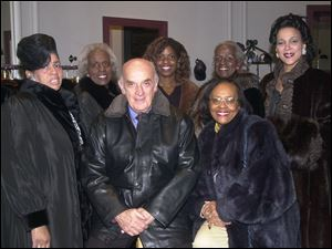 RAFFLE: Modeling furs for a fund-raiser are, from left, Druscilla G. Griffin, Tracci Harmon, Edrene Cole, front, Equilla G. Roach, and Denise Black-Poon. Roth Furs owner Philip Roth is in front.