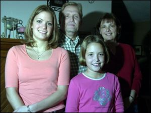 Ralph and Sherry Pierce, parents of Amanda, left, and Kyle, have ambitious plans for educating their daughters.