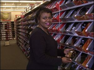 Precious Gibson, a shoe store manager, won praise from her adviser for saving for retirement.