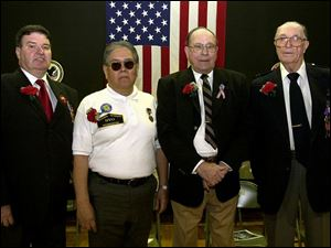 Area veterans James Decant, Jr., Frederick Garcia, Russell Frautschi, and Ivy Church, Sr., from left, were honored.