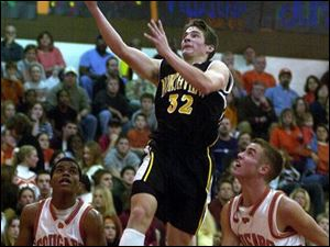 Northview's Adam Hirschfeld drives the lane against Southview's Mike Norris (24) and Eric Savory.