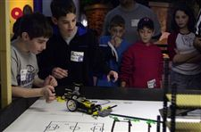 Junior-high-students-in-control-as-robots-romp-Lego-landscape