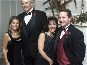 'HOLLY BALL:' Sponsors Renee and Bob Huebner and Amy and John Spengler enjoy the evening's events. Couples danced past midnight after a stately dinner.