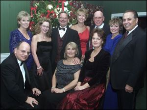 DINNER-DANCE: The 'Walking in a Winter Wonderland' dance committee at Heatherdowns Country Club included: Sitting from left, Larry Tomczak, Laura White, and Cindy Licata. Standing, Penny Trombley, Pati Andray, Norm White, Julie Hayes, Bill and Sharon Streicher, and Joe Licata.