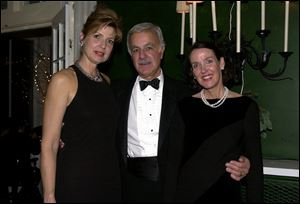 POLO BALL: Kathy and George Athanas, from left, enjoy the Carranor Hunt Club's annual dance with Elizabeth Hepker.