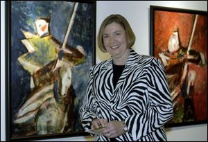 OPENING RECEPTION: Carol Block with her oil paintings, which were described as alive with colors and light.