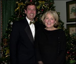 WINTER DANCE: Tom and Gretchen Downs attend 'The Holiday Snow Ball' at the Belmonth Country Club.