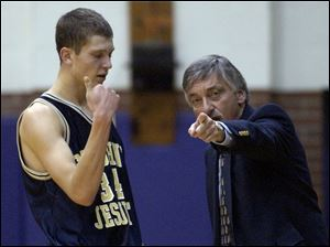St. John's coach Ed Heintschel directs Zach Hillesland, who had 13 points in a 79-52 win over Woodward.