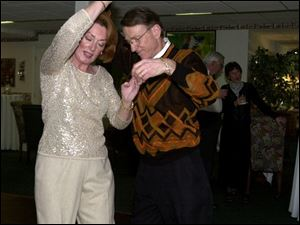 Sue and Chuck Vrooman dance at the Cauffiels' party, which raised funds for a tutoring organization.