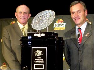 Miami coach Larry Coker, left, and Ohio State boss Jim Tressel eye the object of tonight's Fiesta Bowl - the national championship trophy. Coker's Hurricanes have a quick-strike offense. Tressel's Buckeyes have an excellent defense.