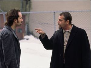 Jason Patric, left, and Ray Liotta play tightly wound officers.