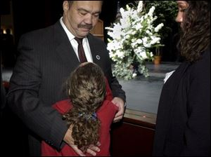 After his speech, Mayor Jack Ford gets a hug from his daughter, Jacqueline, 8.