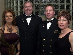 CLUBBERS: Rita Hoff and husband Doug Hoff, commodore of the Sailing Club, and Tim Mikolajczak, commodore of the Maumee club, and wife Kathy are part of the event.