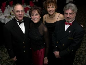 OFFICIALS: Commodore of the Toledo Yacht Club Jack Pozsik and wife Deborah and Commodore of Bay View Bill Lenz and wife Pauline enjoy the Port Winter Ball.