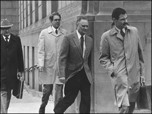 Edward P. Wolfram, second from right, leaves the federal courthouse in Toledo during his April, 1983 trial.