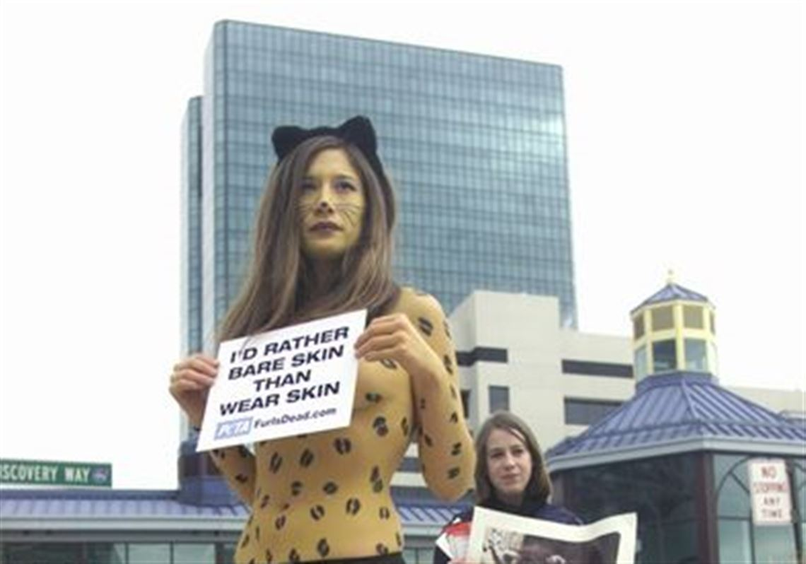 Brandi Valladolid, in leopard makeup, and LeAnne Short protest the wearing  of fur as