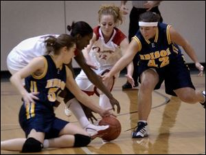 Edison's Carrie Bergman, left, and Amber Kruckeberg battle for a loose ball with Owens players Laura Wilson (12) and Sherita Jackson. Wilson had 14 points, 4 assists and 5 steals.